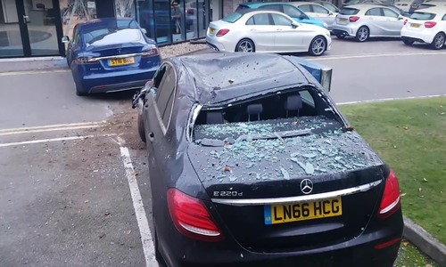 Tesla Crashes into mercedes shop