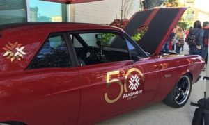 Pictured is the 1967 Ford Falcon, restored by Fanshawe students. The vehicle boasts custom seats embroidered with Fanshawe College falcon mascot, a new engine, a glossy red paint job, a powerful sound system and fuzzy dice on the rear-view.