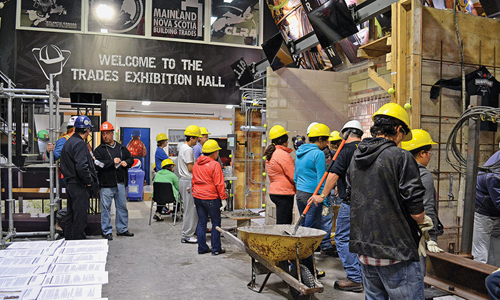 "The NSCSC Trades Exhibition Hall follows a kind of ""speed dating"" formula, as attendees move from booth to booth over the course of several hours, testing out a number of careers in the trade."